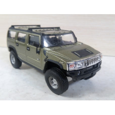 Модель автомобиля Hummer H2 зеленый (1/43)